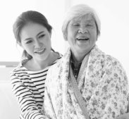 lady and old woman smiling