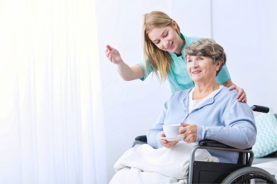 picture of women take care of elderly disabled patient
