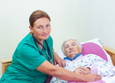 elderly women with her caregiver at home